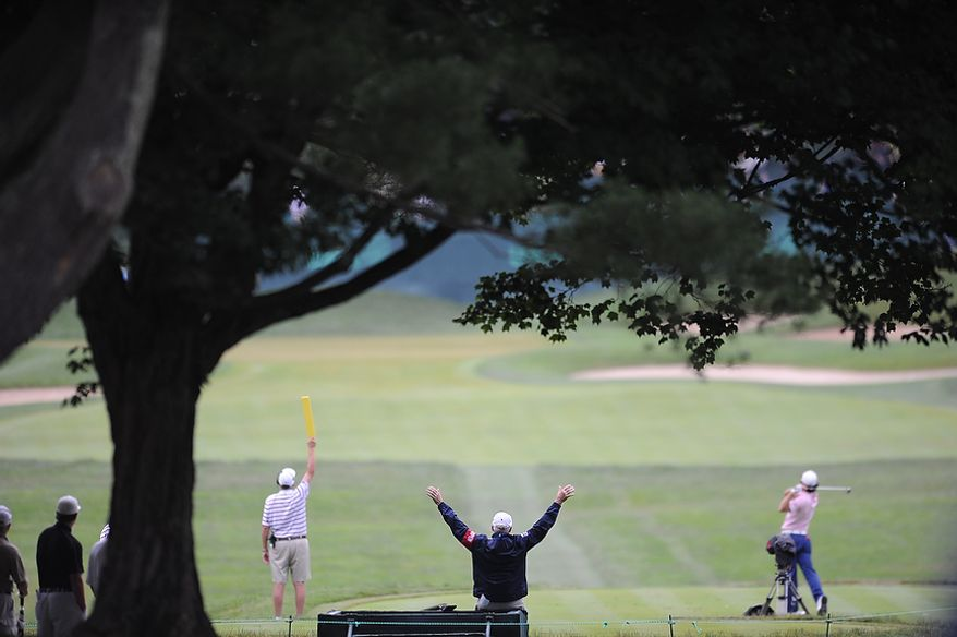 U.S. Open marshals call for quiet during the first round of the U.S. Open at Congressional Country Club in Bethesda, Md., Thursday, June 16, 2011. (Rod Lamkey, Jr./The Washington Times)