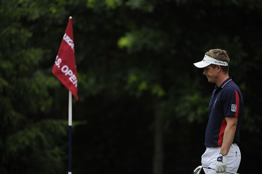 Luke Donald, of England, waits to putt on the 12th hole during the first round of the U.S. Open at Congressional Country Club in Bethesda, Md., Thursday, June 16, 2011. (Drew Angerer/The Washington Times)