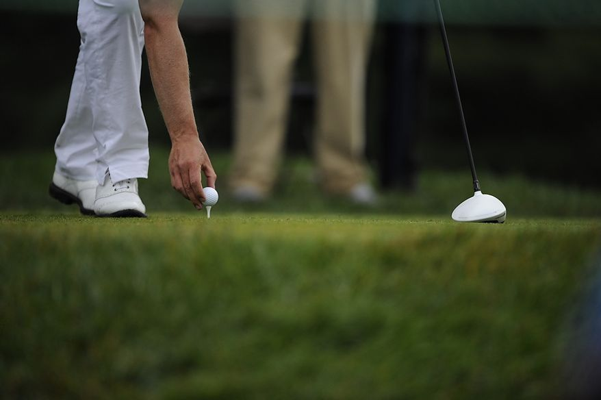 Luke Donald, of England, tees up a ball during the first round of the U.S. Open at Congressional Country Club in Bethesda, Md., Thursday, June 16, 2011. (Drew Angerer/The Washington Times)