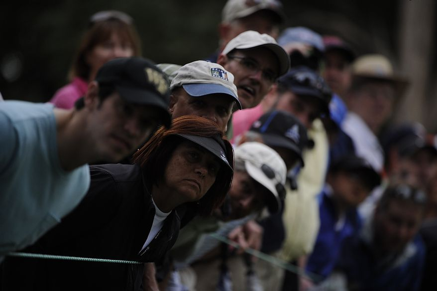 Fans look to see where Luke Donald's fairway shot on the 13th hole lands during the first round of the U.S. Open at Congressional Country Club in Bethesda, Md., Thursday, June 16, 2011. (Drew Angerer/The Washington Times)
