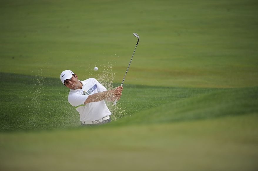 Francesco Molinari, of Italy, hits out of a bunker on the par-4 8th hole during the first round of the U.S. Open at Congressional Country Club in Bethesda, Md., Thursday, June 16, 2011.(Drew Angerer/The Washington Times)