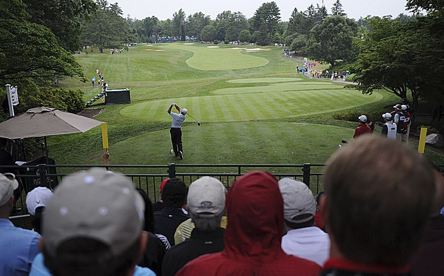 Maryland's own Fred Funk tees off on the first hole to open his first round of the U.S. Open at Congressional Country Club in Bethesda, Md., Thursday, June 16, 2011. (Rod Lamkey, Jr./The Washington Times)