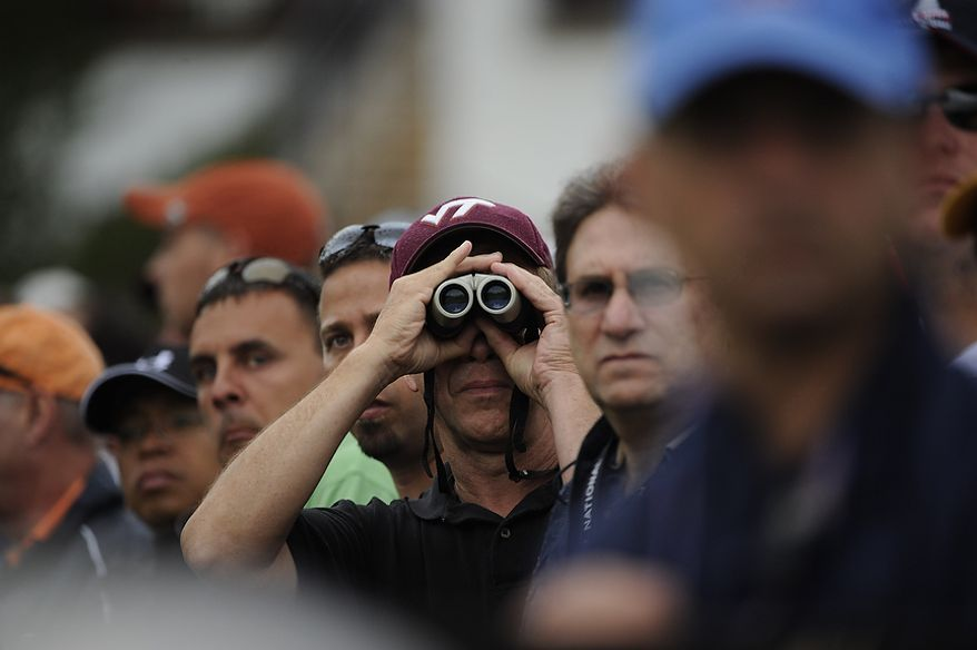 Fans watch players tee off on the 10th hole during the first round of the U.S. Open at Congressional Country Club in Bethesda, Md., Thursday, June 16, 2011. (Drew Angerer/The Washington Times)