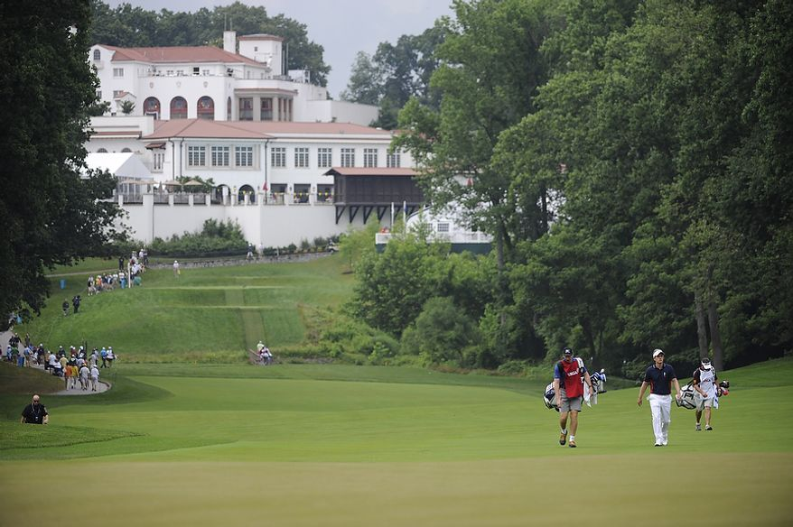 Luke Donald, of England, walks up the 11th fairway during the first round of the U.S. Open at Congressional Country Club in Bethesda, Md., Thursday, June 16, 2011. (Drew Angerer/The Washington Times)