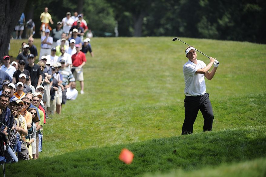 Jeff Overton hits a fairway shot on his way to a double bogey on the 14th hole during the first round of the U.S. Open at Congressional Country Club in Bethesda, Md., Thursday, June 16, 2011. (Drew Angerer/The Washington Times)