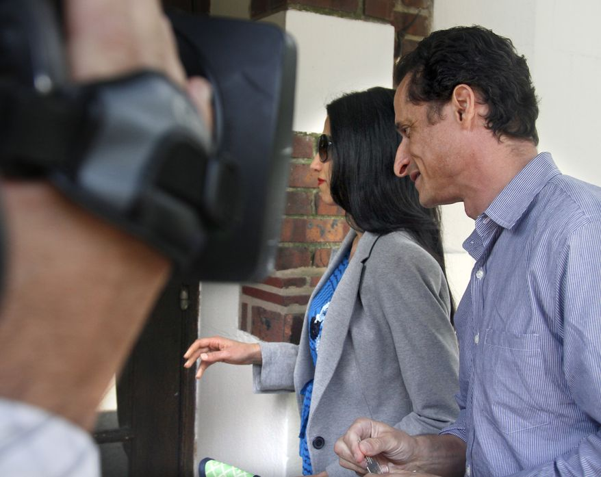 Rep. Anthony D. Weiner and his wife, Huma Abedin, arrive at their home in the New York borough of Queens on Thursday, June 16, 2011, before he left for a press conference to announce his resignation from Congress. (AP Photo/Bebeto Matthews)