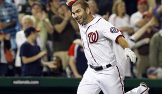 Washington Nationals' Danny Espinosa tosses his helmet into the air after hitting a game-winning three-run home run off St. Louis Cardinals reliever Fernando Salas during the 10th inning of a baseball game in Washington, Thursday, June 16, 2011. The Nationals beat the Cardinals 7-4. (AP Photo/Ann Heisenfelt)