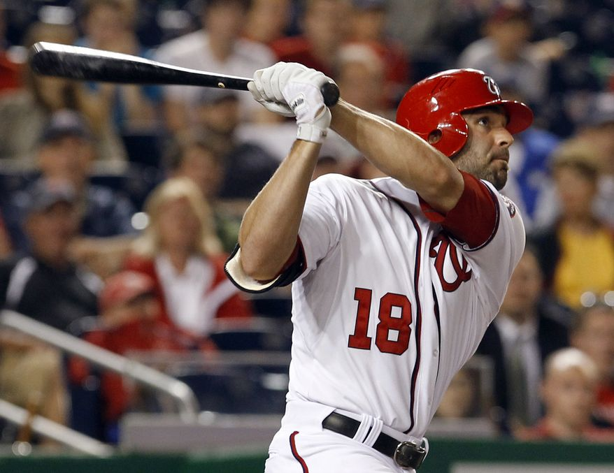Washington Nationals' Danny Espinosa watches the flight of his game-winning three-run home run off St. Louis Cardinals reliever Fernando Salas during the 10th inning of a baseball game in Washington, Thursday, June 16, 2011. The Nationals beat the Cardinals 7-4. (AP Photo/Ann Heisenfelt)