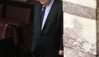 Greek Defence Minister Evangelos Venizelos enters the Parliament to attend an emergency meeting of Socialist lawmakers, in Athens, Thursday, June 16, 2011. Venizelos was appointed as new Finance Minister after Prime Minister George Papandreou reshuffled the Cabinet. (AP Photo/Dimitri Messinis)