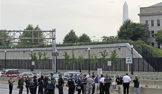 "Law enforcement work near the Pentagon after a suspicious vehicle forced multiple road closures Friday, June 17, 2011 in Arlington, Va. One person was taken into custody early Friday morning in Arlington National Cemetery after it closed. ""This is an unfolding situation,"" said U.S. Park Police. Police were investigating a suspicious package in the man's car parked in the bushes near the Pentagon's North Parking lot. (AP Photo/Alex Brandon)"