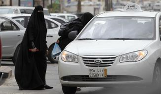 ** FILE ** In this Tuesday, May 24, 2011, file photo, Saudi women board a taxi in Riyadh, Saudi Arabia. A campaign to defy Saudi Arabia's ban on women driving opened Friday, June 17, 2011, with female motorists getting behind the wheel. (AP Photo/Hassan Ammar, File)
