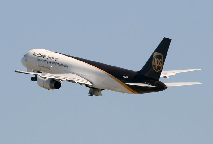 In this Tuesday, June 14, 2011, photo, a UPS Boeing 757-24APF cargo plane takes off from Miami International Airport in Miami. Shipping company UPS has been barred from moving air cargo through some U.K. facilities because of security flaws, the British government said Friday, June 17, 2011. (AP Photo/Wilfredo Lee)