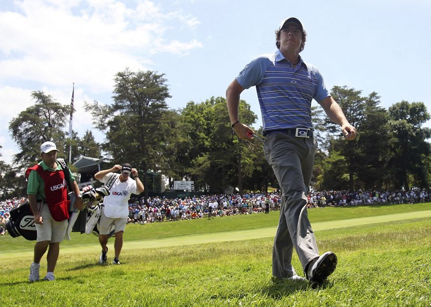 Rory McIlroy, of Northern Ireland, walks off the 18th hole during the second round of the U.S. Open Championship golf tournament in Bethesda, Md., Friday, June 17, 2011. (AP Photo/Mike Groll)