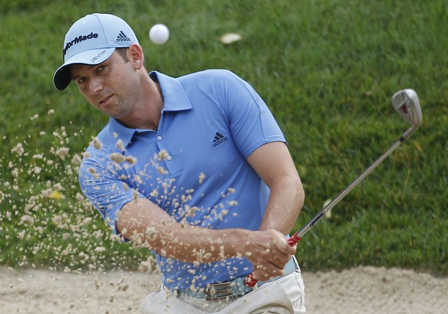 Sergio Garcia, of Spain, hits from the bunker to the 11th green during the second round of the U.S. Open Championship golf tournament in Bethesda, Md., Friday, June 17, 2011. (AP Photo/Eric Gay)