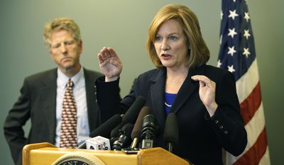 """U.S. Attorney Jenny Durkan, right, talks to reporters, Friday, June 17, 2011, in Seattle, as San Juan County prosecutor Randall Gaylord looks on at left, after Colton Harris-Moore, known as the """"Barefoot Bandit,"""" pleaded guilty to seven charges stemming from a multi-state crime spree that included the thefts of several airplanes and boats. (AP Photo/Ted S. Warren)"""