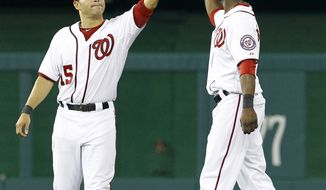Washington Nationals' Jerry Hairston, left, and Roger Bernadina celebrate after beating the Baltimore Orioles 8-4 in an interleague baseball game in Washington, Friday, June 17, 2011. (AP Photo/Ann Heisenfelt)