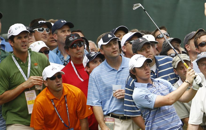 The crowd watches Rory McIlroy, of Northern Ireland's shot on the 18th hole during the second round of the U.S. Open Championship golf tournament in Bethesda, Md., Friday, June 17, 2011. (AP Photo/Evan Vucci)
