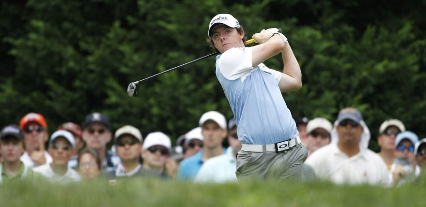 Rory McIlroy, of Northern Ireland, watches his drive from the fifth tee during the third round of the U.S. Open Championship golf tournament in Bethesda, Md., Saturday, June 18, 2011. (AP Photo/Eric Gay)