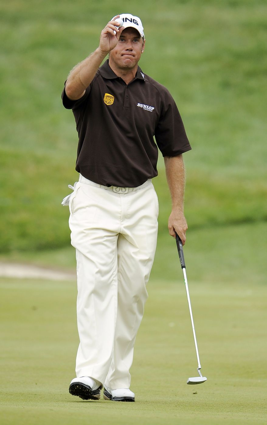 Lee Westwood, of England, acknowledges the gallery as he walks off of the 18th green during the third round of the U.S. Open Championship golf tournament in Bethesda, Md., Saturday, June 18, 2011. (AP Photo/Nick Wass)