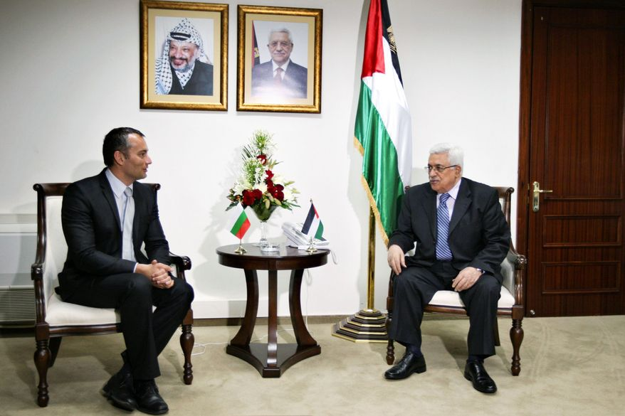 ASSOCIATED PRESS PHOTOGRAPHS Palestinian President Mahmoud Abbas (above right) meets with Bulgarian Foreign Minister Nikolay Mladenov on Saturday in the West Bank. Israeli Prime Minister Benjamin Netanyahu (left) plans visits soon to Poland, Hungary, Romania and Bulgaria regarding the Palestinian statehood issue.