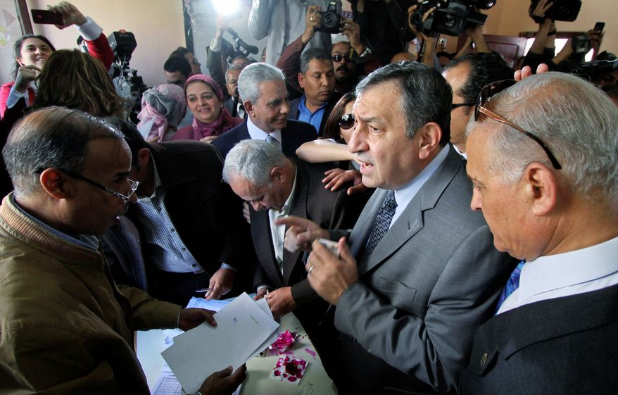 Associated Press Egyptian Prime Minister Essam Sharaf, seen here in March before taking office, speaks to an electoral observer as he casts his vote in Cairo during a referendum on constitutional amendments. Mr. Sharaf now favors postponing parliamentary elections scheduled for September until a new constitution is drafted.