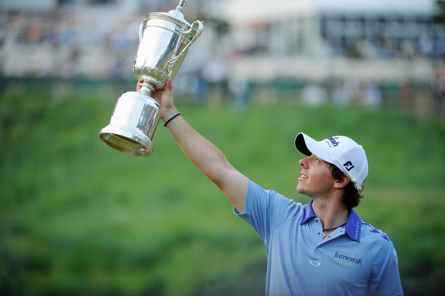 Rory McIlroy holds aloft the U.S. Open trophy after winning the championship at Congressional Country Club in Bethesda, Md., Sunday, June 19, 2011. (Drew Angerer/The Washington Times)