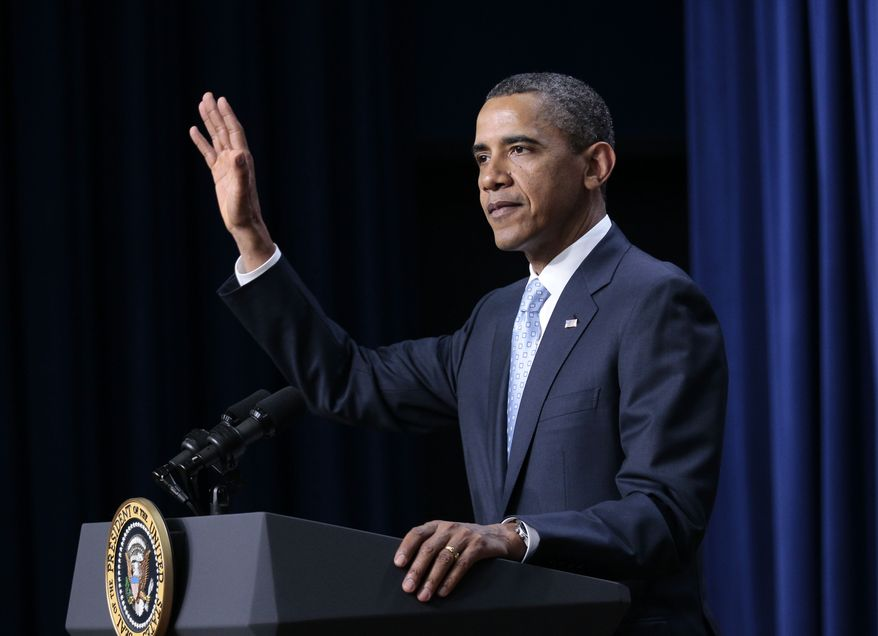 President Barack Obama gestures in the South Court Auditorium of the Eisenhower Executive Office Building on the White House complex, Wednesday, June 15, 2011. (AP Photo/Pablo Martinez Monsivais)