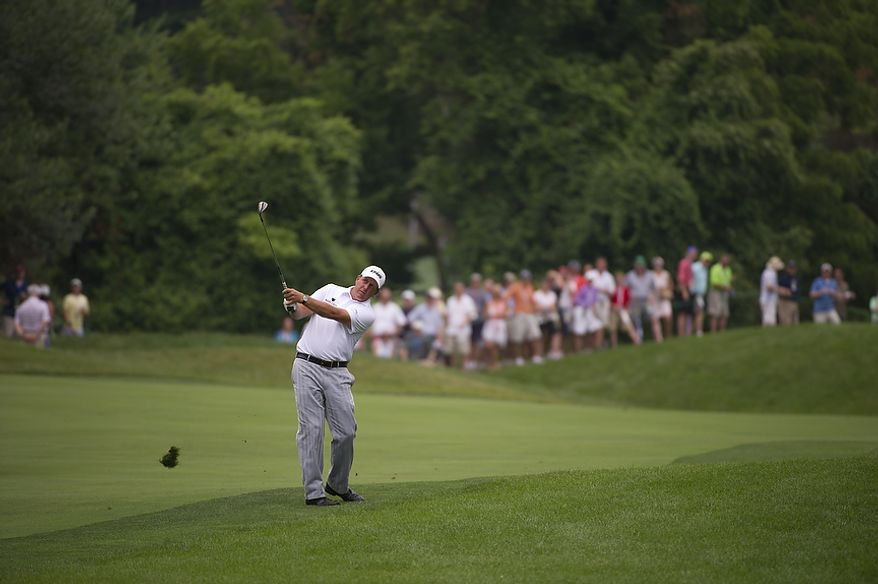 Phil Mickelson takes a shot from the sixth fairway during the championship round of the 2011 U.S. Open Congressional, in Bethesda, Md., Sunday, June 19, 2011. (Rod Lamkey Jr./The Washington Times)