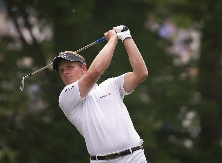 Luke Donald tees off on the seventh hole during the championship round of the 2011 U.S. Open Congressional, in Bethesda, Md., Sunday, June 19, 2011. (Rod Lamkey Jr./The Washington Times)
