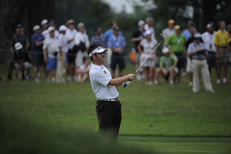 Defending U.S. Open champion, Louis Oosthuizen, of South Africa, prepares to tee off on the first hole during the final round of the U.S. Open at Congressional Country Club in Bethesda, Md., Sunday, June 19, 2011. (Drew Angerer/The Washington Times)