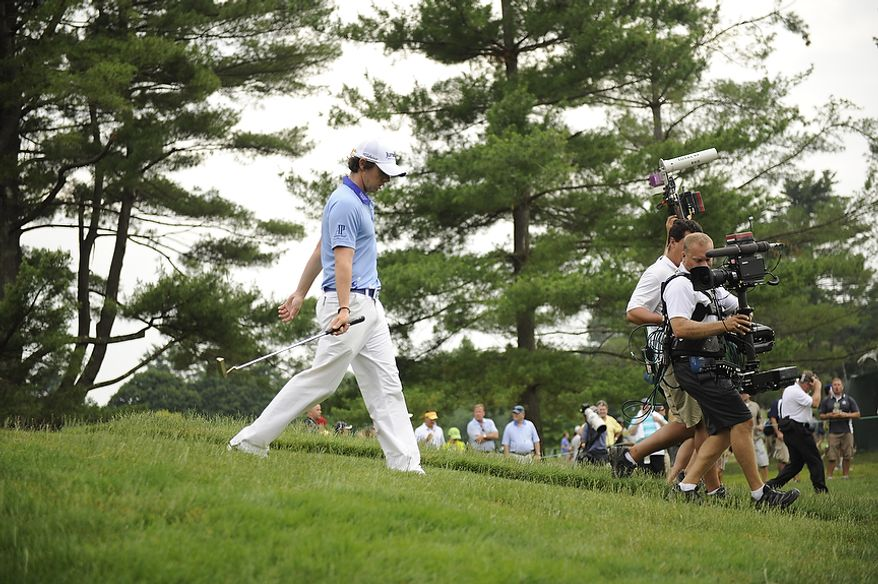 Tournament leader Rory McIlroy, of Northern Ireland, walks down the first fairway during his final round of the U.S. Open at Congressional Country Club in Bethesda, Md., Sunday, June 19, 2011. (Drew Angerer/The Washington Times)