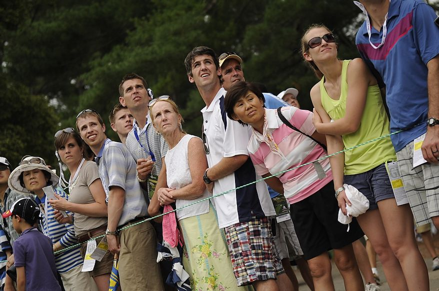 Fans watch the drive of tournament leader Rory McIlroy, off of the second tee during his final round of the U.S. Open at Congressional Country Club in Bethesda, Md., Sunday, June 19, 2011. (Drew Angerer/The Washington Times)
