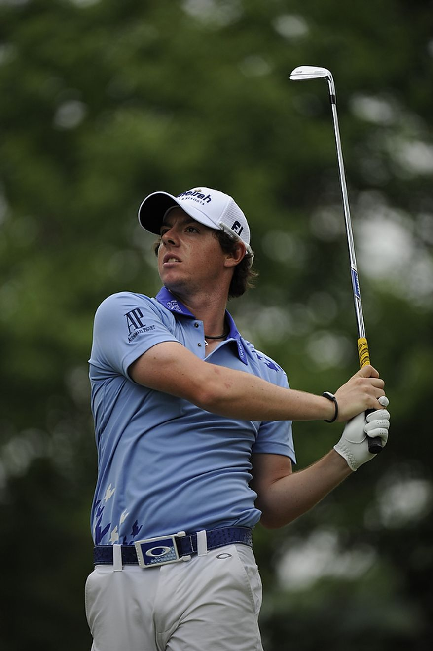 Tournament leader Rory McIlroy, of Northern Ireland, hits a shot on the sixth hole under during his final round of the U.S. Open at Congressional Country Club in Bethesda, Md., Sunday, June 19, 2011. (Drew Angerer/The Washington Times)