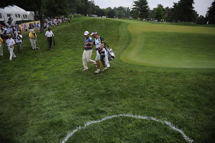 Lee Westwood and his caddie Billy Foster walk from the second green to the third tee during the final round of the U.S. Open at Congressional Country Club in Bethesda, Md., Sunday, June 19, 2011. (Rod Lamkey, Jr./The Washington Times)