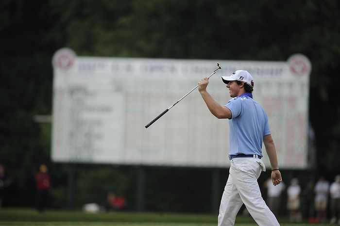 Rory McIlroy, of Northern Ireland, acknowledges the gallery on the 18th green before his final putt to win the U.S. Open at Congressional Country Club in Bethesda, Md., Sunday, June 19, 2011. (Drew Angerer/The Washington Times)