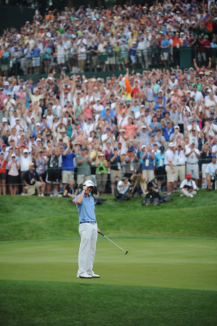 Rory McIlory, of Northern Ireland, raises his fist after holing out a putt on the 18th green to finish -2 for the day and -16 for the tournament to win the U.S. Open championship at Congressional Country Club in Bethesda, Md., Sunday, June 19, 2011. (Rod Lamkey, Jr./The Washington Times)