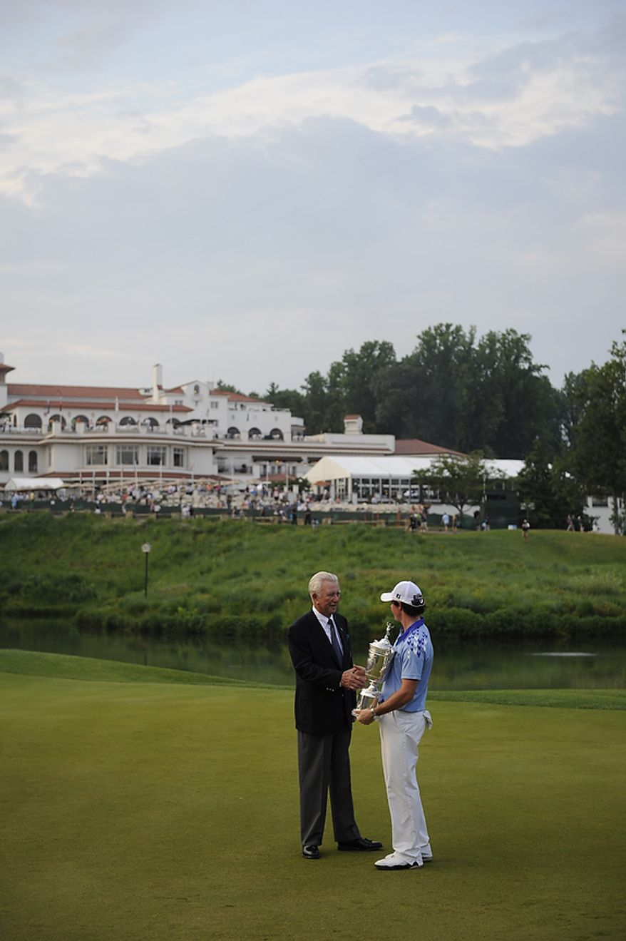 Rory McIlory shakes hands with 1964 champion Ken Venturi after winning the 2011 U.S. Open at Congressional Country Club in Bethesda, Md., Sunday, June 19, 2011. (Rod Lamkey, Jr./The Washington Times)