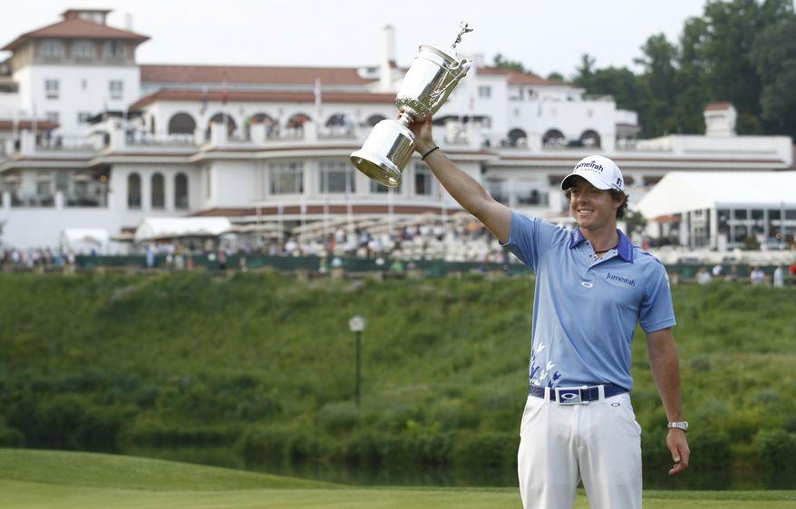Rory McIlroy, of Northern Ireland, poses with the trophy after winning the U.S. Open Championship golf tournament in Bethesda, Md., Sunday, June 19, 2011. McIlroy won the U.S. Open for his first major with a record setting 16-under 268. (AP Photo/Evan Vucci)