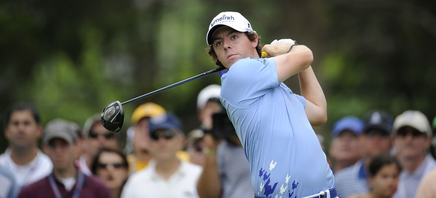Rory McIlroy, of Northern Ireland, tees off on the third hole during the final round of the U.S. Open Championship golf tournament in Bethesda, Md., Sunday, June 19, 2011. (AP Photo/Nick Wass)