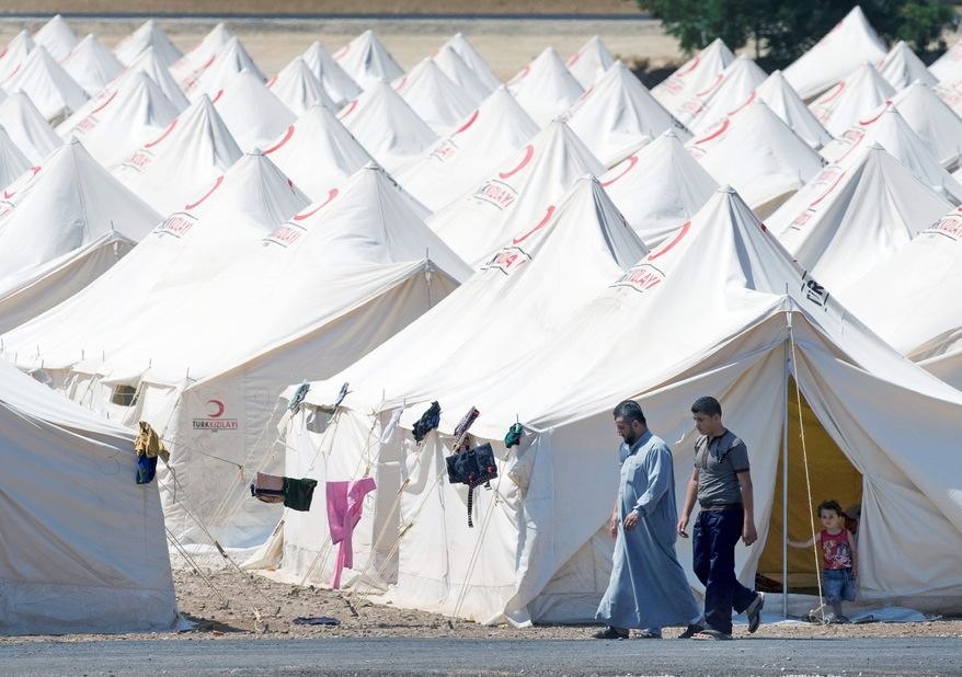 A newly opened camp in the Turkish town of Reyhanli in Hatay province is one of many providing shelter for refugees from the violence in Syria. Estimates on the number of refugees range from 10,000 to 30,000. (Associated Press)