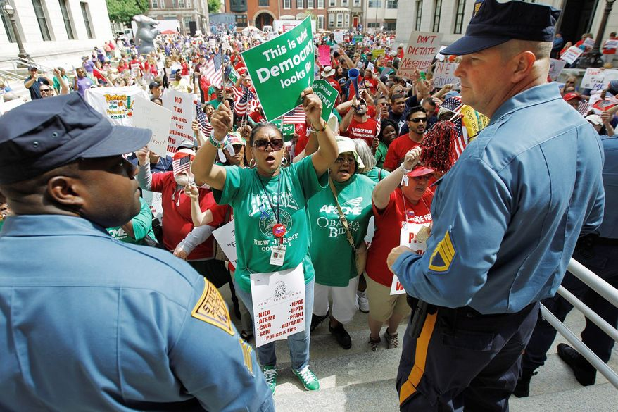 Ginger Adamson leads supporters of the American Federation of State, County and Municipal Employees Local 2211 near the New Jersey Statehouse, where lawmakers were considering pension and health care legislation. (Associated Press)