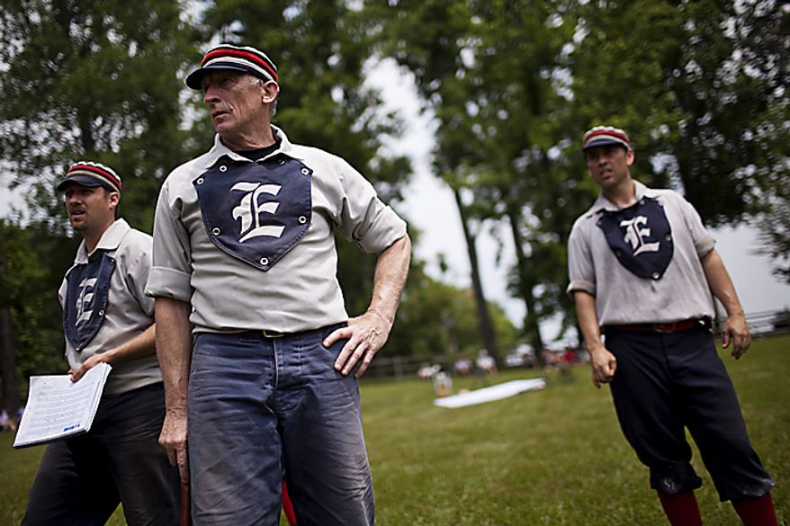 "From left, Elkton Eclipse players Lee ""Brew"" Donelson, Bill ""Pockets"" Freeland and Tim ""Ones"" Bower look on as their team bats against the Potomac Nine team during the Loudoun Preservation Society's 19th Century Baseball Day at the Oatlands, in Leesburg, Va., Sunday, June 12, 2011. The teams, part of the Mid Atlantic Vintage Baseball League, all wear the same style of uniforms that teams did in the 1860s, but they don't make their jerseys out of wool due to the heat. (Drew Angerer/The Washington Times)"