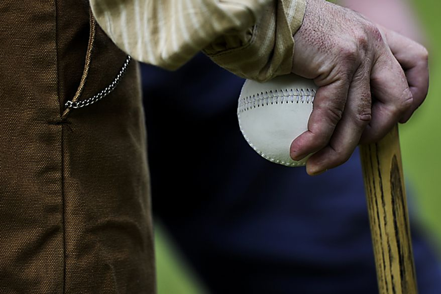 Umpire Richard D'Ambrisi holds the game ball during the Loudoun Preservation Society's 19th Century Baseball Day at the Oatlands, in Leesburg, Va., Sunday, June 12, 2011. There are a few interesting facts about the 1860s era ball that was used. First, it is made of mostly leather and is much softer than modern baseballs. This is because players in this era did not use a glove, so a softer ball allows them to handle the ball more easily using bare hands. Also during this era of baseball, only one ball was used during the entire game, so that meant tracking down every foul ball and getting it quickly back to the pitcher, unlike today's game where a new ball is put in play every few pitches. (Drew Angerer/The Washington Times)