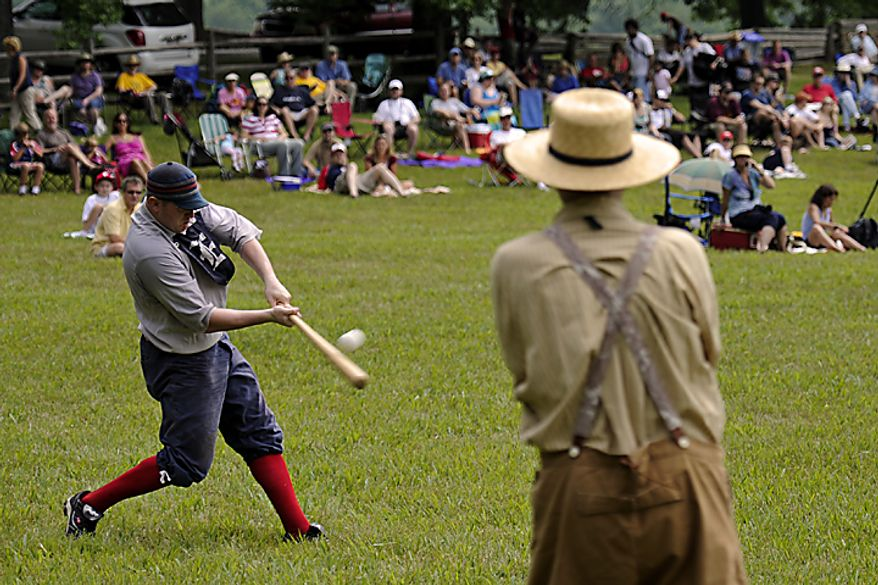 "Elkton Eclipse outfielder Glyn ""Hammer"" Richards, left, of Mt. Ephraim, N.J., hits a pitch during a game during the Loudoun Preservation Society's 19th Century Baseball Day at the Oatlands, in Leesburg, Va., Sunday, June 12, 2011. The bats they used during the 1860s era are a little different from today's bats. Still made of wood, the vintage era bats had a thicker handle but a more narrow barrel. (Drew Angerer/The Washington Times)"