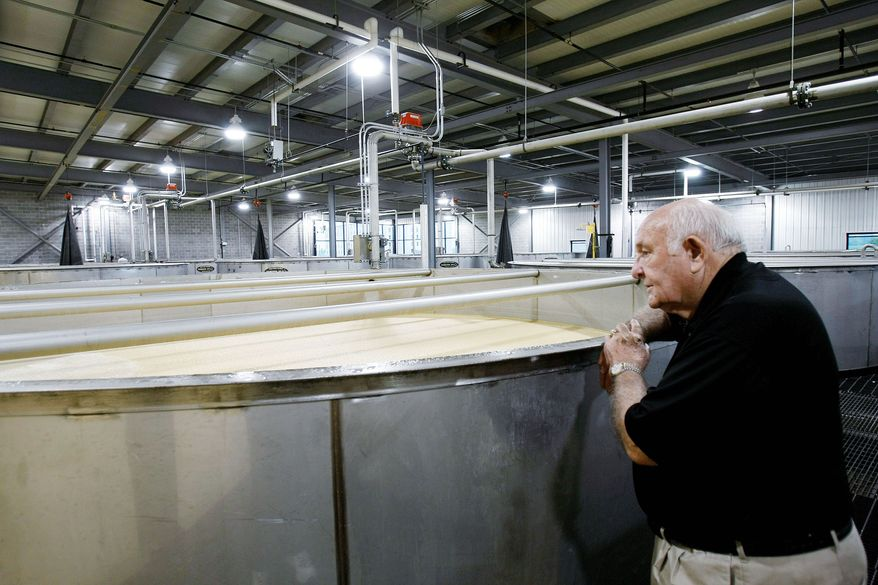 Jimmy Russell looks over one of the 23 new fermenters Wild Turkey Distillery has installed in an expansion at the plant. Automation has led to an increase in production.