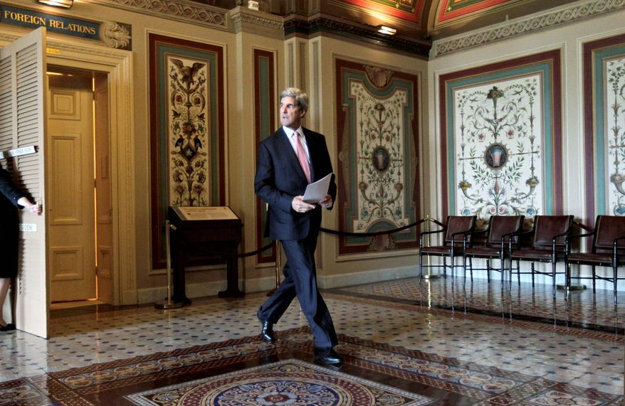 "ASSOCIATED PRESS Senate Foreign Relations Committee Chairman John Kerry, Massachusetts Democrat, makes his way to the Senate floor, where he introduced a bipartisan resolution Tuesday to authorize continued use of ""limited"" U.S. military force in Libya. The resolution is co-sponsored by Sen. John McCain, Arizona Republican."