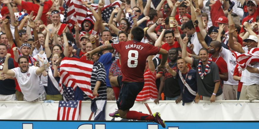 United States' Clint Dempsey (8) reacts after his goal during the second half of a CONCACAF Gold Cup quarterfinal soccer match against Jamaica on Sunday, June 19, 2011, at RFK Stadium. The United States won 2-0. (AP Photo/Alex Brandon)