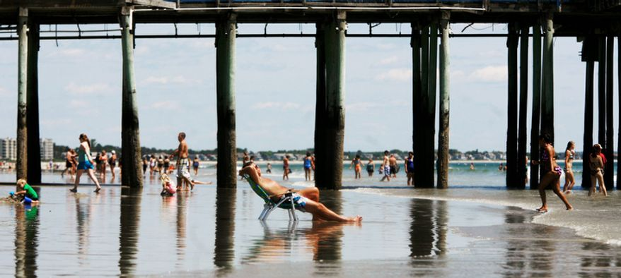 People enjoy the first day of summer at Old Orchard Beach, Maine on Tuesday, June 21, 2011.  (AP Photo/Pat Wellenbach)