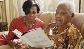 U.S. first lady Michelle Obama visits former South African President Nelson Mandela at his home in Houghton, South Africa, on Tuesday, June 21, 2011. (AP Photo/Debbie Yazbek, Nelson Mandela Foundation)