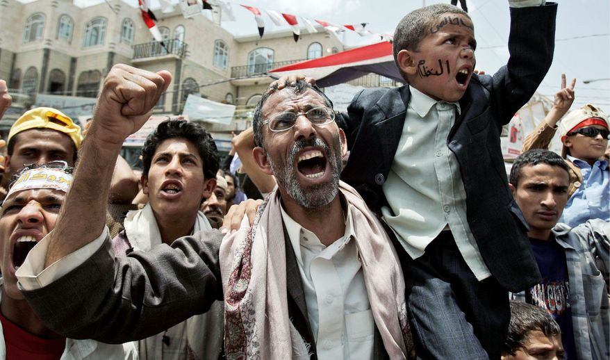 Anti-government protestors, shout slogans during a demonstration demanding the resignation of Yemeni President Ali Abdullah Saleh, in Sanaa, Yemen, Wednesday, June 22, 2011. Security officials say 57 militants, mostly from al-Qaida, have escaped from a prison in southern Yemen. They say the 57 were among 62 inmates from the Mukalla jail in the Hadarmout province who escaped Wednesday through an underground tunnel. (AP Photo/Hani Mohammed)
